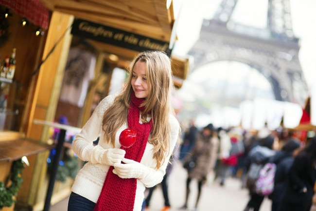 16010106-Happy young girl with caramel apple on a Parisian Christmas market with the Eiffel tower